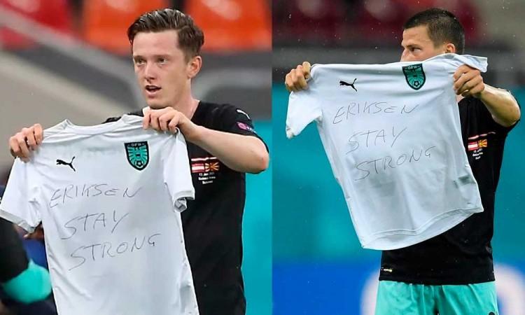 Los jugadores Stefan Lainer y Michael Gregoritsch mandan mensaje de ánimos a Eriksen