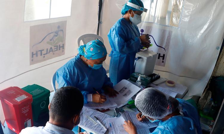 Colombia marca otro récord diario con 13.990 contagios de covid-19