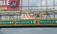 Exhiben con mantas cifras de violencia de género en Tehuacán