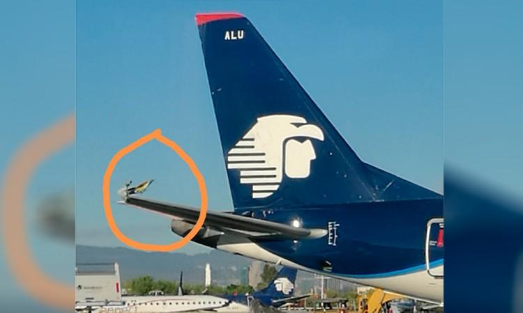 Activan protocolo de seguridad por roce de aviones en AICM