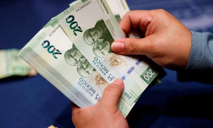 El peso cierra cerca de su mínimo histórico frente al dólar