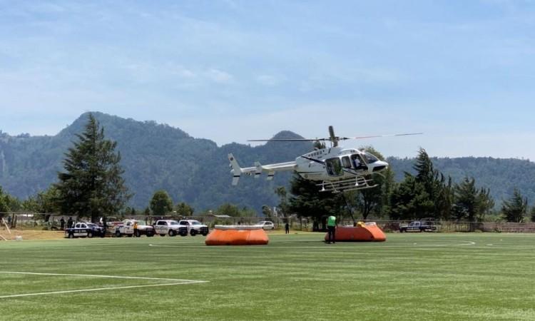 Helicóptero-cisterna realiza más de 50 descargas en incendio de Tlatempa