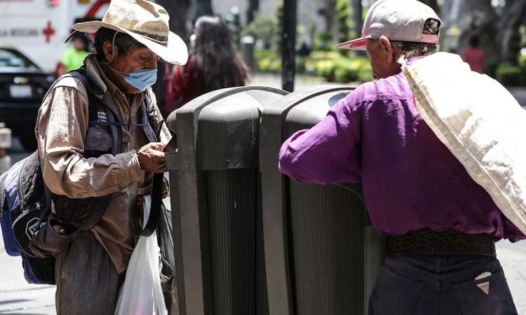 Calles de Puebla capital se llenan con toneladas de basura
