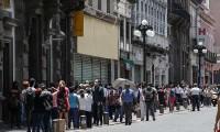 Fijan atención en bancos de Puebla por superar afluencia permitida