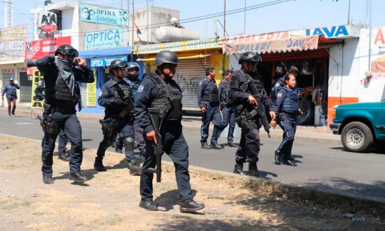 Enfrentamiento entre policías y grupo delictivo en el mercado Morelos