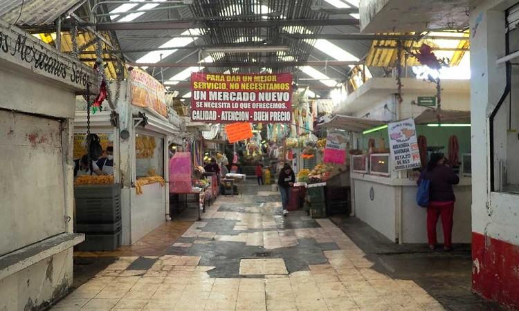 """""""El que quiera, a nadie se le obligará"""", comerciantes deciden si regresan o no al Mercado Amalucan"""