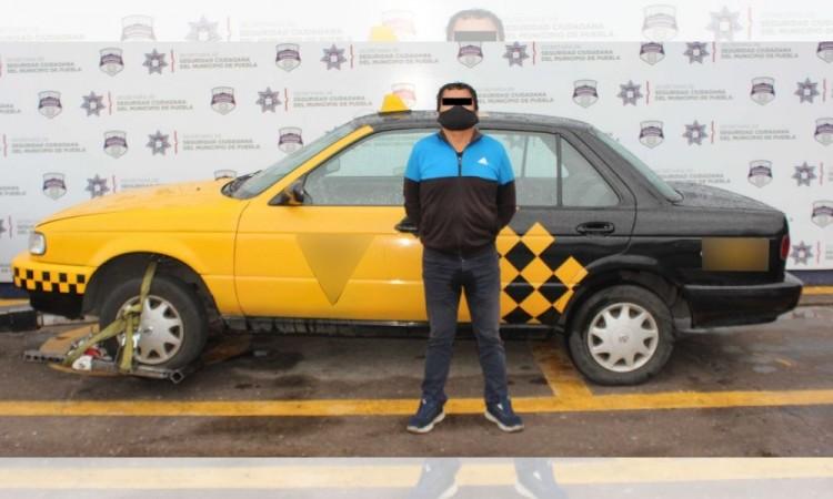 Detienen a hombre por robo a interior de vehículo