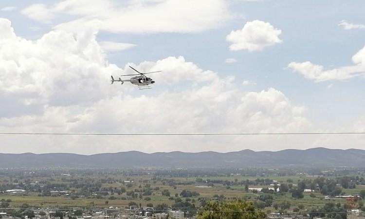 El cortejo fúnebre fue resguardado por un helicóptero de la Policía Estatal Preventiva.