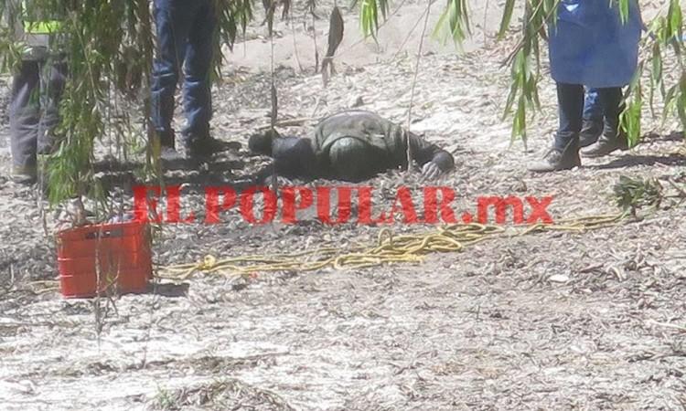 Hallan cadáver flotando en el río Atoyac